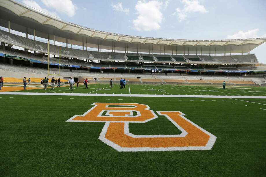 FILE - This Aug. 18, 2014 file photo shows the Baylor University logo on the football field at McLane Stadium in Waco, Texas. A long-running spat between the world's largest Baptist school and the Baylor Alumni Association over actions the school claims is hurting its brand is scheduled for a January court showdown over civil lawsuits each has filed against the other. (AP Photo/Waco Tribune Herald, Rod Aydelotte, File) Photo: Rod Aydelotte, MBO / Associated Press / Waco Tribune Herald