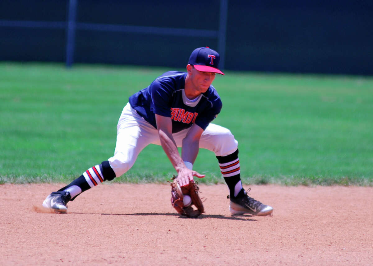 Trumbull Senior Legion shortstop Frank LaPegna collects a gound ball during a state playoff game against Westport on Sunday, July 19, 2015 at Trumbull High School in Trumbull, Connecticut. Trumbull won 4-3.