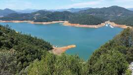 From Shasta Caverns on the McCloud Arm of Shasta Lake, this is what Shasta Lake looks like in mid July, 2015 -- a non-manipulated photo designed to show whether the lake is high or low