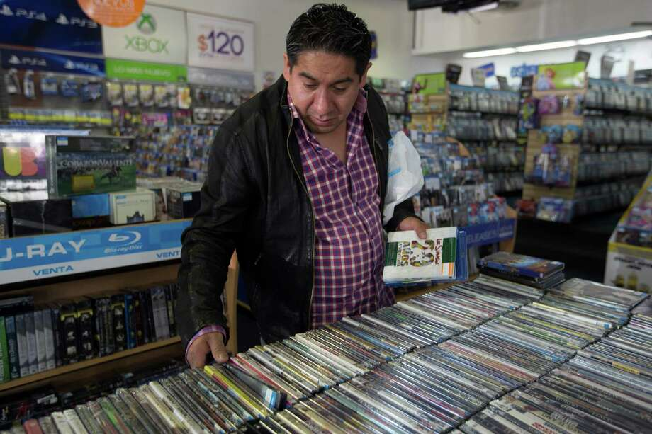 A man looks at movies for sale at a Blockbuster store in Mexico City, Mexico, on Thursday, July 16, 2015. Blockbuster, Woolworth and Sears -- extinct or barely hanging on in the U.S. -- are getting an afterlife from Mexican billionaires and other investors who look past the mustiness and see profits. Photographer: Susana Gonzalez/Bloomberg Photo: Photos By Susana Gonzalez / Bloomberg / © 2015 Bloomberg Finance LP