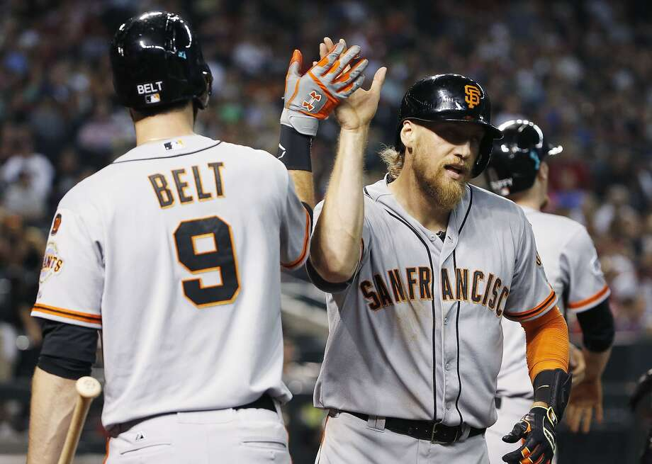 San Francisco Giants' Hunter Pence, right, gets a high-five from teammate Brandon Belt after Pence connected for a home run against the Arizona Diamondbacks during the seventh inning of a baseball game Friday, July 17, 2015, in Phoenix. (AP Photo/Ross D. Franklin) Photo: Ross D. Franklin, Associated Press