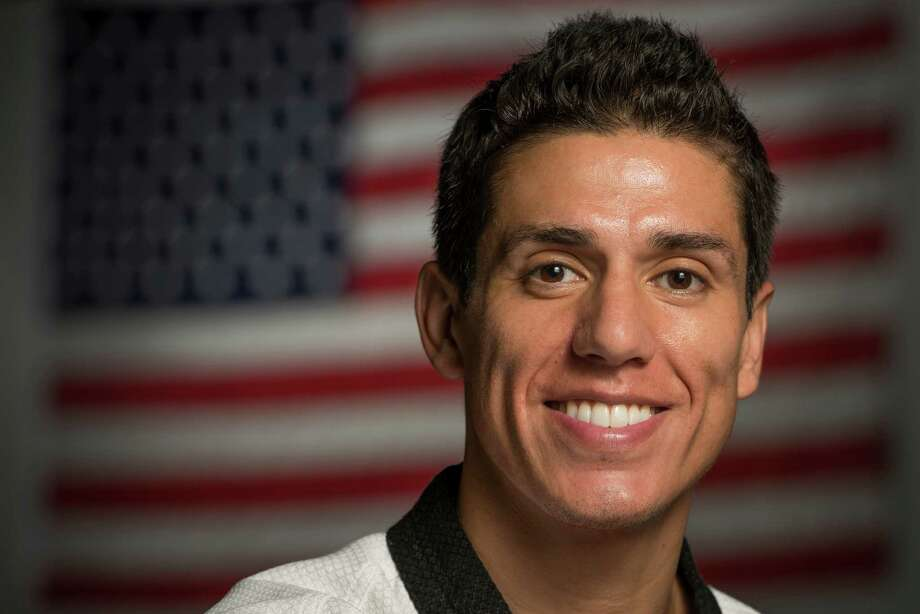 Four-time Olympian Steven Lopez poses for a portrait at Lopez Taekwondo on Thursday, July 12, 2012, in Sugar Land. Lopez and his sister Diana will represent the USA at the 2012 London Olympics. ( Smiley N. Pool / Houston Chronicle) Photo: Smiley N. Pool, Staff / ©   Houston Chronicle