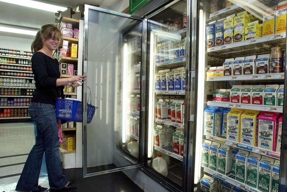 At Marina Super Market on Chestnut Street in San Francisco, Nikki Tankursley picks up a gallon of milk, on Wednesday, July 28, 2004. Photo: Carlos Avila Gonzalez, SFC