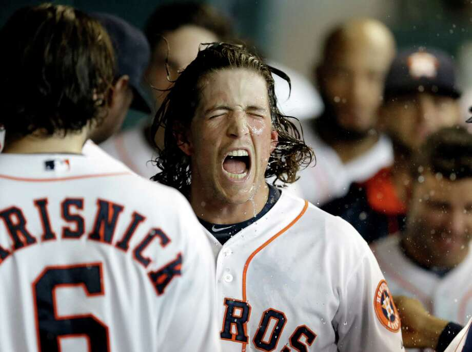 Colby Rasmus' two-run homer in the third inning gives the Astros more than enough insurance on the way to a 10-0 victory over the Rangers on Sunday. Photo: Pat Sullivan, STF / AP