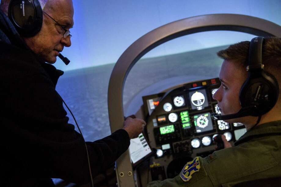 """Brad and Aaron discuss the training. """"When I look back, this will be a big part of Air Force history,"""" Aaron says of remotely piloted aircraft. Photo: Ray Whitehouse /San Antonio Express-News / 2015 San Antonio Express-News"""