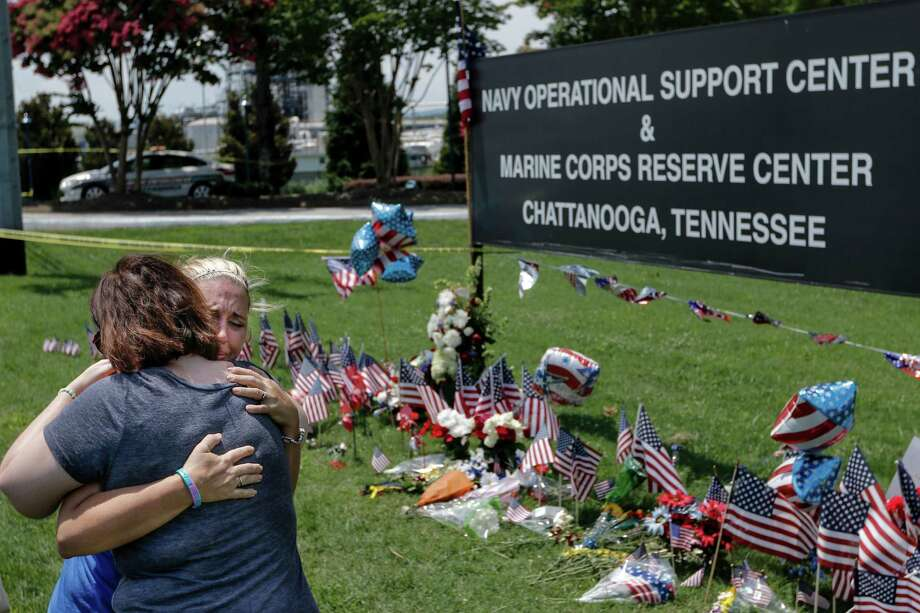 Sophia Ensley, right, and Barbie Branum embrace in front of a makeshift memorial at the Navy Operational Support Center and Marine Corps Reserve Center, Saturday, July 18, 2015, for the victims of the July 16 shootings  in Chattanooga, Tenn. The U.S. Navy says a sailor who was shot in the attack on a military facility in Chattanooga has died, raising the death toll to five people. (Doug Strickland/Chattanooga Times Free Press via AP) THE DAILY CITIZEN OUT; NOOGA.COM OUT; CLEVELAND DAILY BANNER OUT; LOCAL INTERNET OUT; MANDATORY CREDIT Photo: Doug Strickland, MBI / Associated Press / Chattanooga Times Free Press