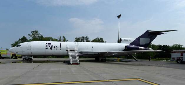 A former FedEx Boeing 727 is now a full-time member of the airport fire department after its donation at Albany International Airport Friday morning, June 12, 2015, in Colonie, N.Y.  It will be used for fire training evolutions.  (Skip Dickstein/Times Union) Photo: SKIP DICKSTEIN / 00032263A