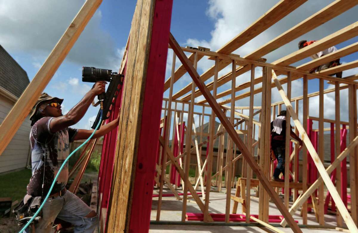 A home under construction has already been sold along the 6500 block of Granbury Rd. in the Lakeland housing plan currently under construction Friday, July 17, 2015, in Manvel. Manvel is preparing for the anticipated growth by setting up its road plan, parks plan and other preparations. ( Gary Coronado / Houston Chronicle )