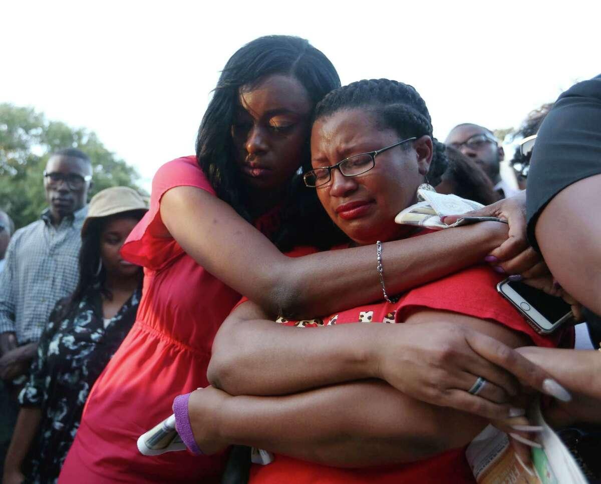 Lanitra Dean hugs Carlesha Harrison, a friend of Sandra Bland, during a vigil at Prairie View A&M University Sunday, July 19, 2015, in Prairie View.