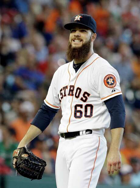 Dallas Keuchel has reason to smile after silencing the Rangers' bats for seven innings Sunday. Photo: Pat Sullivan, STF / AP