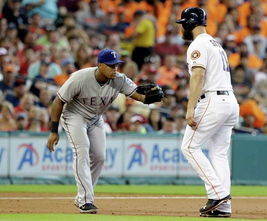 Astros designated hitter Evan Gattis has nowhere to go with Rangers third baseman Adrian Beltre waiting to make the tag in the second inning Sunday at Minute Maid Park. Photo: Pat Sullivan, STF / AP