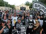 Spurs fans gather at the Alamo during a march and rally to welcome new players LaMarcus Aldridge, David West, and others to the team Sunday July 19, 2015.