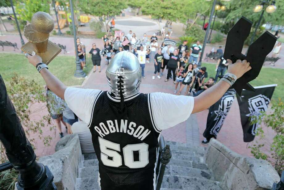 "Spurs fan Rick ""Spurs Nation"" Vela and others gather in Milam Park prior to a march and rally to the Alamo to welcome new players LaMarcus Aldridge, David West, and others to the team Sunday July 19, 2015. Photo: Edward A. Ornelas, San Antonio Express-News / © 2015 San Antonio Express-News"
