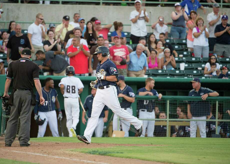 San Antonio Missions' Hunter Renfroe runs to home plate after hitting a home run against the Frisco Roughriders during a Texas League baseball game, Sunday, July 19, 2015, at Wolff Stadium in San Antonio. Photo: Darren Abate /For The Express-News / San Antonio Express-News