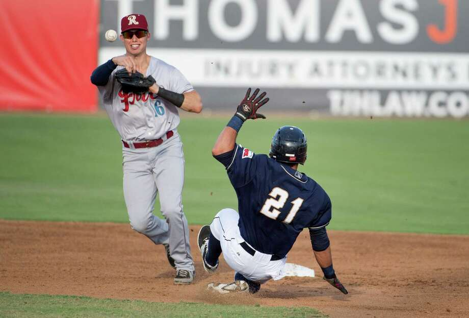San Antonio Missions runner Alberth Martinez (21) is tagged out at second by Frisco Roughriders' Drew Robinson during a Texas League baseball game, Sunday, July 19, 2015, at Nelson Wolff Municipal Stadium in San Antonio. San Antonio won 9-1. (Darren Abate/For the Express-News) Photo: Darren Abate, FRE / Darren Abate/Express-News / San Antonio Express-News