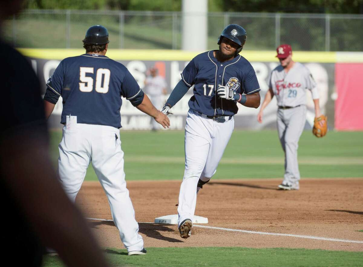 San Antonio Missions' Duanel Jones (17) celebrates a home run with Missions manager Rod Barajas during a Texas League baseball game against the Frisco Roughriders, Sunday, July 19, 2015, at Wolff Stadium in San Antonio. San Antonio won 9-1.