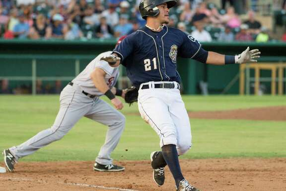 San Antonio Missions runner Alberth Martinez (21) lands safe at first base during a Texas League baseball game against the Frisco RoughRiders, Sunday, July 19, 2015, at Wolff Stadium in San Antonio.