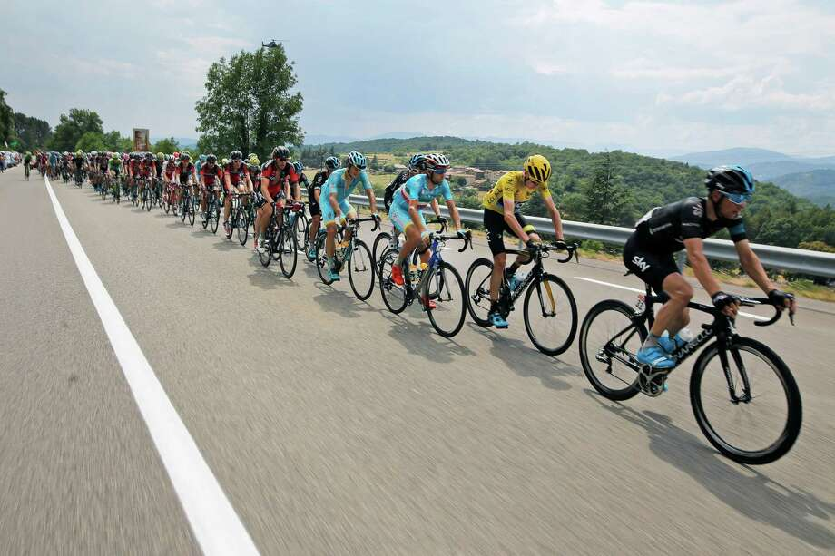 Britain's Chris Froome, wearing the overall leader's yellow jersey, Italy's Vincenzo Nibali, to Froome's left, and Denmark's Jakob Fuglsang, ride during the fifteenth stage of the Tour de France cycling race over 183 kilometers (113.7 miles) with start in Mende and finish in Valence, France, Sunday, July 19, 2015. (AP Photo/Laurent Cipriani) ORG XMIT: PDJ134 Photo: Laurent Cipriani / AP