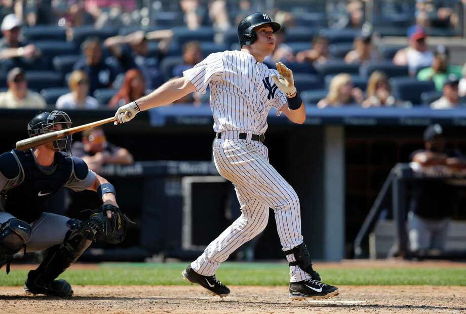 New York Yankees Mark Teixeira watches his eighth-inning solo home run in a baseball game against the Seattle Mariners at Yankee Stadium in New York, Sunday, July 19, 2015.  (AP Photo/Kathy Willens) ORG XMIT: NYY110 Photo: Kathy Willens / AP
