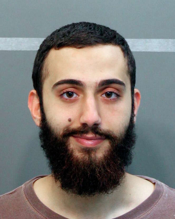 In a booking photo provided by the Hamilton County SheriffOs Office, Mohammod Abdulazeez, identified by federal investigators as the gunman who fatally shot four Marines and a Navy petty officer in Chattanooga, Tenn. on July 16, 2015. In a city of increasing diversity, Abdulazeez and his academically and professionally accomplished family seemed to be fitting in. (Hamilton County SheriffOs Office via The New York Times) -- FOR EDITORIAL USE ONLY. ORG XMIT: XNYT13 Photo: HAMILTON COUNTY SHERIFF'S OFFICE / HAMILTON COUNTY SHERIFF'S OFFICE