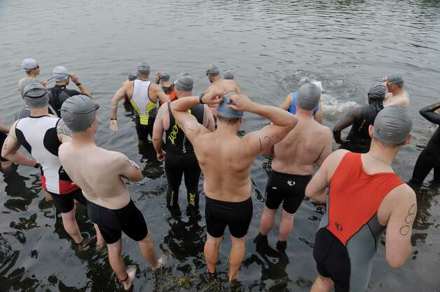 Competitors wait to start the swim portion in the Pine Bush Triathlon at Rensselaer Lake on Sunday, July 19, 2015, in Albany, N.Y.  The contest consists of a 325 yard swim, a 11.5 mile bike ride and a 3.25 mile run, ending at the Guilderland YMCA.   (Paul Buckowski / Times Union) Photo: PAUL BUCKOWSKI / 00032634A