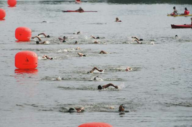 Competitors take part in the swimming portion of the Pine Bush Triathlon at Rensselaer Lake on Sunday, July 19, 2015, in Albany, N.Y.  The contest consists of a 325 yard swim, a 11.5 mile bike ride and a 3.25 mile run, ending at the Guilderland YMCA.   (Paul Buckowski / Times Union) Photo: PAUL BUCKOWSKI / 00032634A