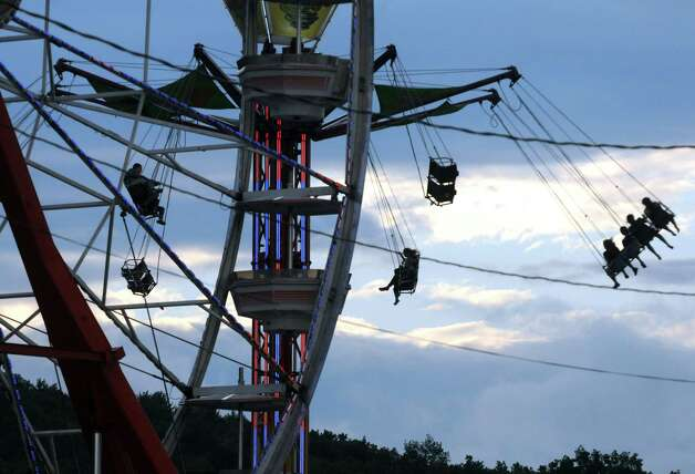 Fair goers take a ride at the Altamont Fair on Tuesday, Aug. 13, 2013, in Altamont, N.Y. (Michael P. Farrell/Times Union) Photo: Michael P. Farrell / 00023489A
