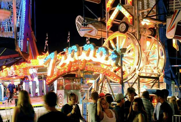 Patrons enjoy the Altamont Fair amusements Tuesday night, Aug. 14, 2012, in Altamont, N.Y. (Will Waldron / Times Union)