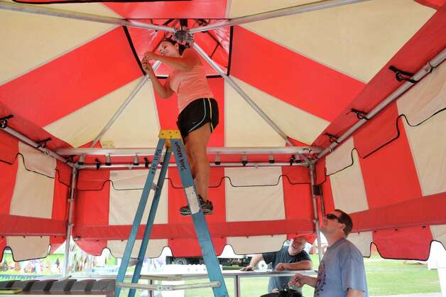 Priscilla Scannell, left, and her husband Willam Scannell from Cape Coral, FL, set up their food concession stand, Butcher Boys, as set up continues for the Saratoga County Fair on Sunday, July 19, 2015, in Ballston Spa, N.Y.   The fair opens on Tuesday.     (Paul Buckowski / Times Union) Photo: PAUL BUCKOWSKI / 00032673A