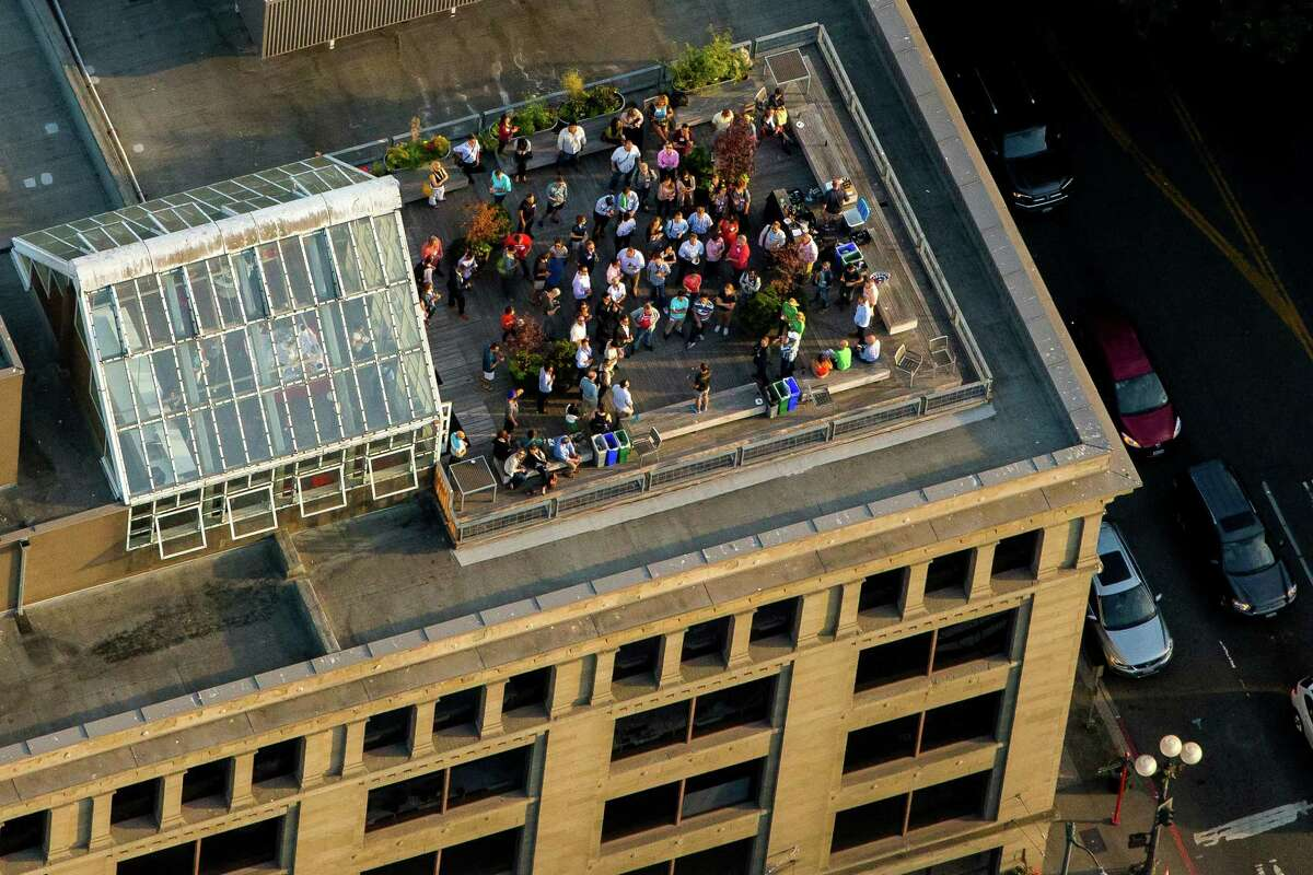 People gather on a downtown Seattle rooftop deck on July 15.