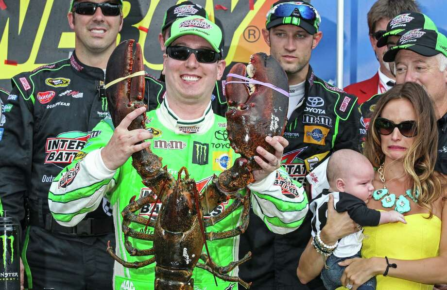 Kyle Busch holds the Loudon lobster trophy in Victory Lane, as his wife, right, Samantha holding son Brexton looks on, after winning the NASCAR Sprint Cup series auto race at New Hampshire Motor Speedway, Loudon, N.H., Sunday, July 19, 2015  (AP Photo/Cheryl Senter) ORG XMIT: NHCS103 Photo: Cheryl Senter / FR62846 AP