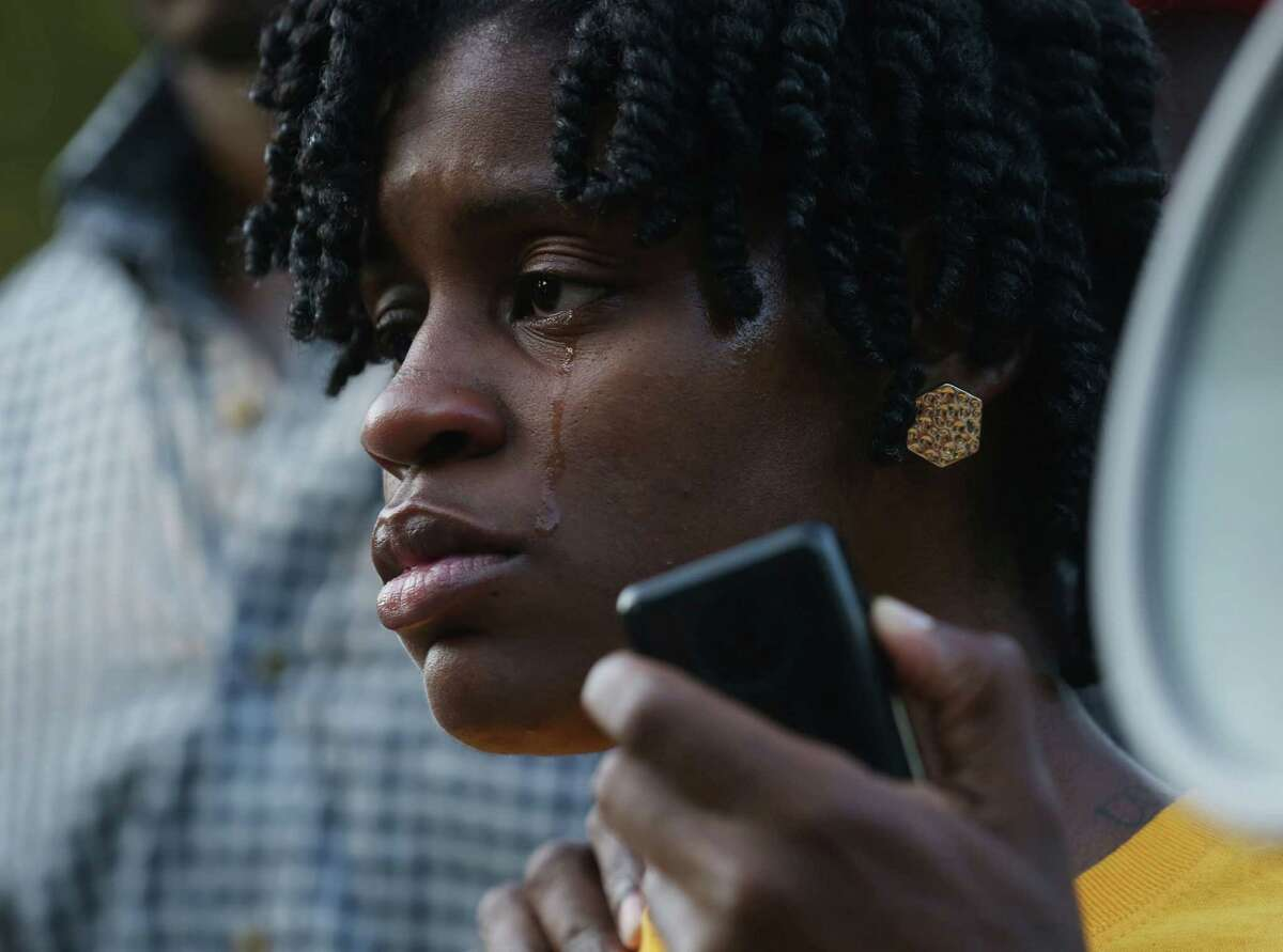Angel Duncan pauses to gather her thoughts while speaking during a vigil for Sandra Bland at Prairie View A&M University Sunday.