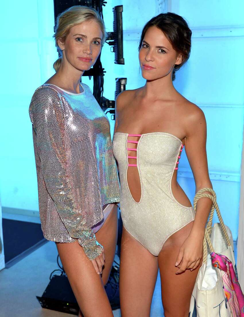 Models prepare backstage at the Belusso 2016 Collection during SWIMMIAMI at 1 Hotel South Beach Salon on July 18, 2015 in Miami Beach, Florida.