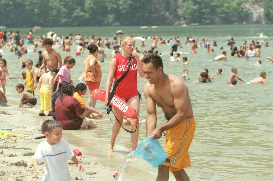 Lifeguard Criste Linkletter, 16, of Sherman, patrols an overflowing Independence Day Friday at Squantz Pond Photo: File Photo/ John P. Lawson / File Photo / The News-Times File Photo
