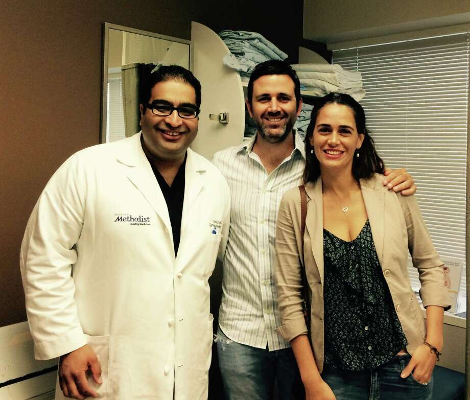 Dr. Anuj Suri, left of Houston Methodist Hospital performed a trachelectomy to treat the early-stage cervical cancer of Ana Carla Cepeda, right, and leave her fertility intact. Cepeda's husband, Pable Arizpe, is at center. Photo: Kyrie O'Connor / ONLINE_YES