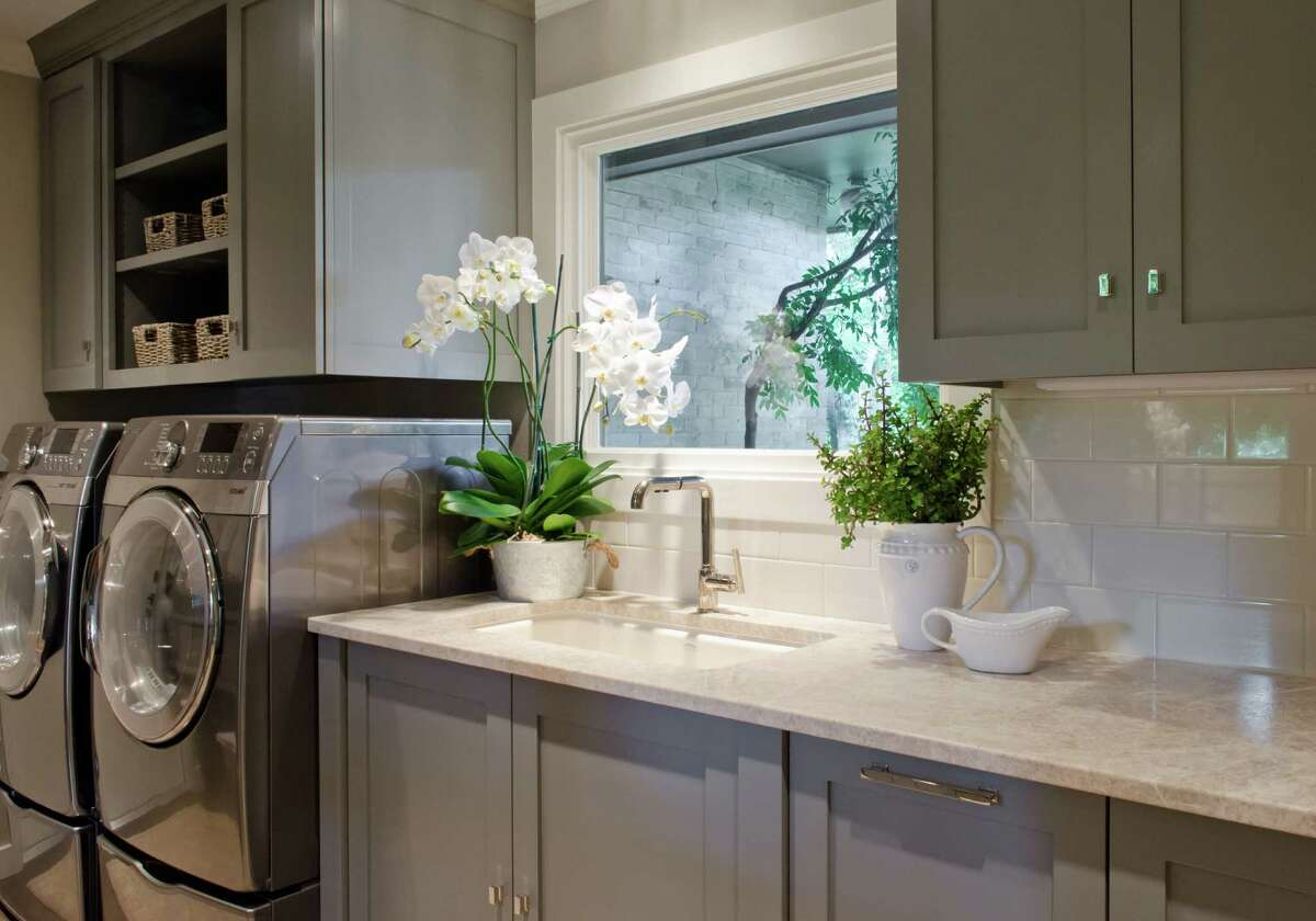 This redone laundry room in Castle Hills, a San Antonio suburb, has all of the basic elements and them some: plenty of counter space, storage, natural and even a sink.
