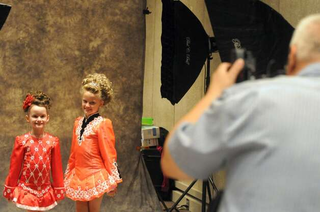 Sisters Shannon, 7, and Allison Dewar from canada pose for a photo taken by John Bollentin of Studio 50 during the 27th Annual Governor Thomas Dongan Feis at the Empire State Plaza on Saturday July 18, 2015 in Albany, N.Y. (Michael P. Farrell/Times Union) Photo: Michael P. Farrell, Albany Times Union