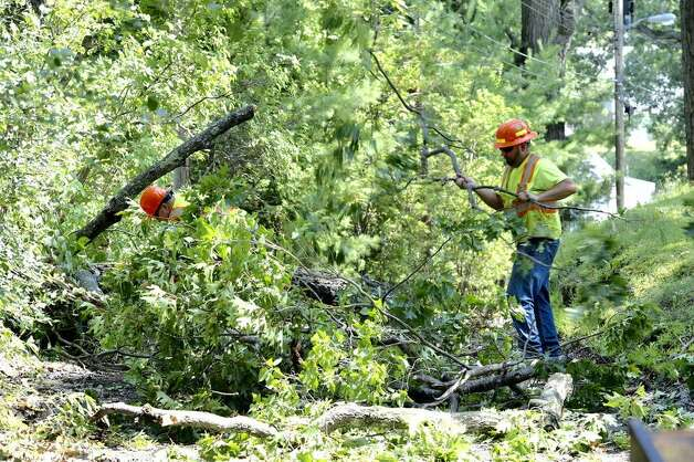 Crews remove downed trees on Small Hawley Point Road near Kinderhook Lake after at storm pummelled Niverville on Sunday.  (Skip Dickstein / Times Union)