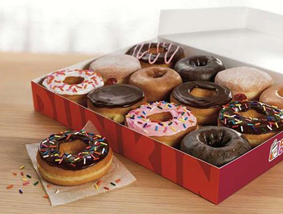 This photo provided by Dunkin' Donuts on Monday, May 5, 2014 shows a selection of the doughnuts they sell. The restaurant chain Dunkin' Donuts is testing whether that deep-fried classic American snack, the doughnut, can compete successfully against entrenched competition from some of the world's most famous sweet snacks in their own homelands, including the waffle in Belgium, apple strudel in Austria and the Danish in Denmark. (AP Photo/Dunkin' Donuts) Photo: Uncredited, Associated Press