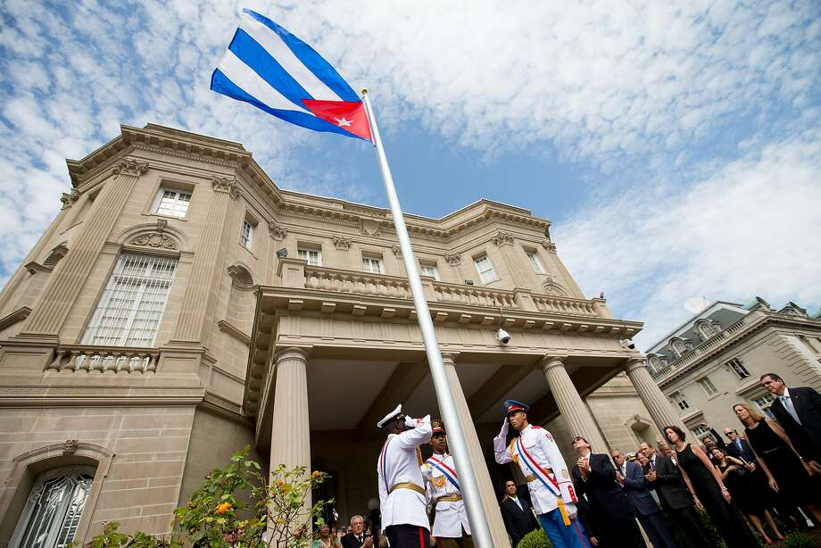 Cuban Foreign Minister Bruno Rodriguez, right of center, applauds with other dignitaries after raising the Cuban flag over their new embassy in Washington, Monday, July 20, 2015. Cuba's blue, red and white-starred flag was hoisted Monday at the country's embassy in Washington in a symbolic move signaling the start of a new post-Cold War era in U.S.-Cuba relations.   (AP Photo/Andrew Harnik, Pool) Photo: Andrew Harnik, Associated Press