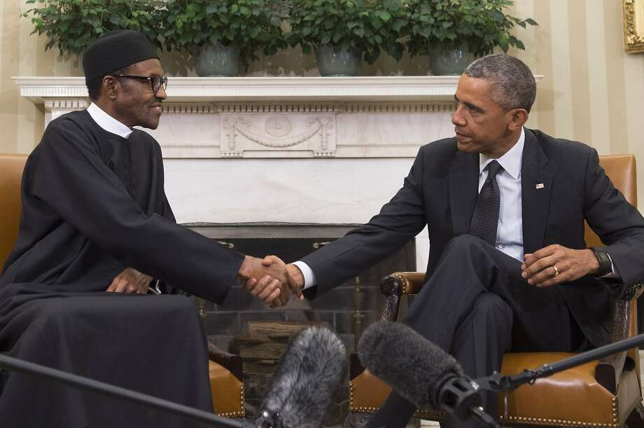 President Obama welcomes Nigerian President Muhammadu Buhari to the Oval Office. Photo: Saul Loeb, AFP / Getty Images