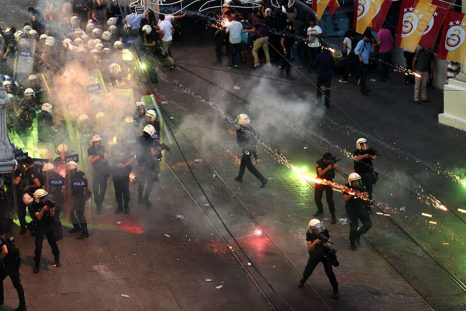 Protesters clash with riot police during a demonstration in Istanbul that began after the suicide bombing attack in Turkey's southern town of Suruc. Photo: Ozan Kose, AFP / Getty Images