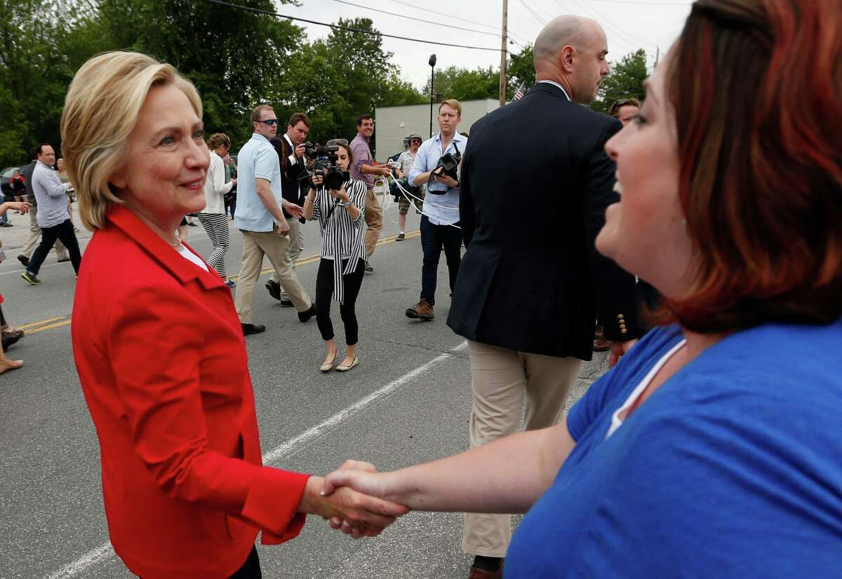 Democratic presidential candidate Hillary Rodham Clinton faced widespread criticism after news outlets published photos showing members of the media being kept behind a moving rope line as the former secretary of statemarched in a Fourth of July parade, Saturday, July 4, 2015, in Gorham, N.H.