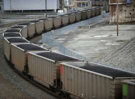A coal train is heading north through the old Georgia-Pacific site in Bellingham, Washington, March 1, 2011. Rail lines that few people noticed for years are suddenly busy with trains, and the increased traffic has generated a backlash in communities across the country. (Philip A. Dwyer/Bellingham Herald/MCT)