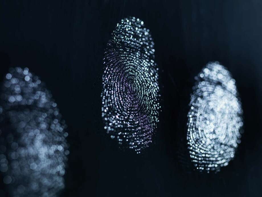 Close up of fingerprints on surface Photo: Cultura Science/Rafe Swan, Getty Images / Andrew Brookes  AB Still Ltd