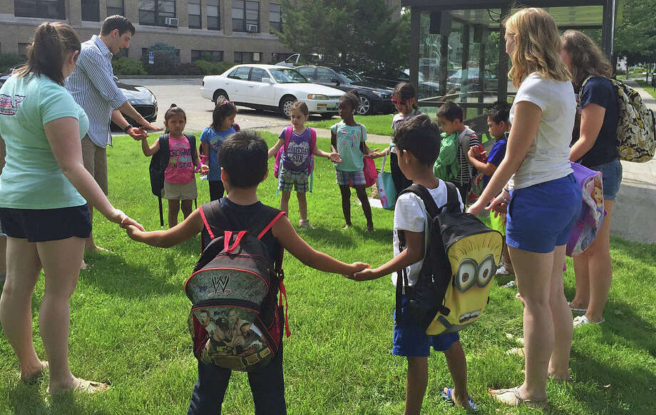 Kindergartners from Danbury's South Street Elementary School with coordinators of the Horizons National program at Western Connecticut State University's Midtown Campus. Photo: / Contributed Photo