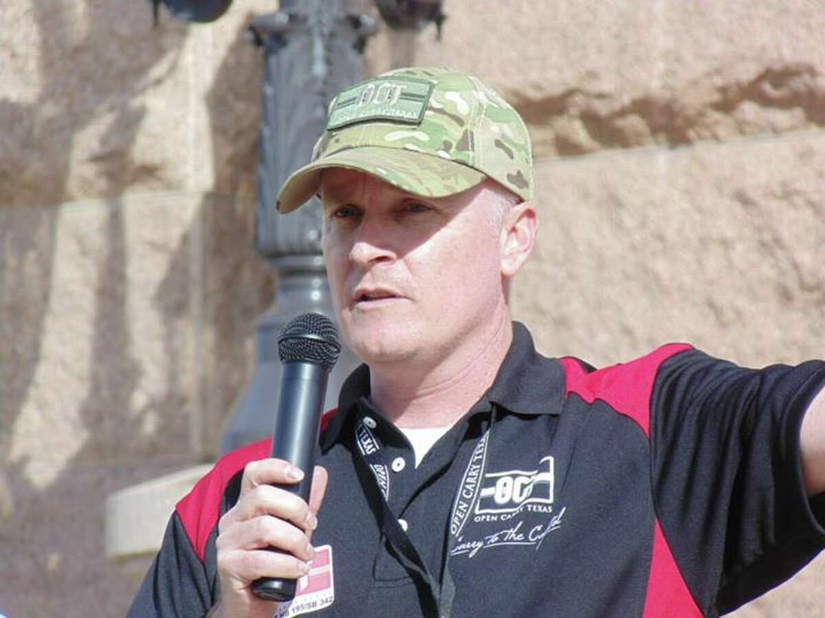 Open Carry Texas CJ Grisham speaks at a rally in front of the state Capitol in 2015.
