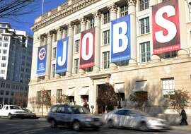 A jobs sign hangs above the entrance to the US Chamber of Commerce building in Washington, DC in this December 13, 2011 file photo. New claims for US unemployment benefits rose modestly last week but the overall trend showed fewer layoffs, government data released September 19, 2013 showed. Initial jobless claims totaled 309,000 in the week ending September 14, up by 15,000 from the prior week's revised 294,000 reading, the Labor Department said. The increase was less than analysts expected, with the average total claims estimate at 340,000.AFP PHOTO / Karen BLEIER / FILESKAREN BLEIER/AFP/Getty Images