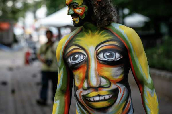 NEW YORK, USA - JULY 19:  A participant in body-paint attends the Bodypainting Day at Dag Hammarskjold Plaza in New York City on July 18, 2015.