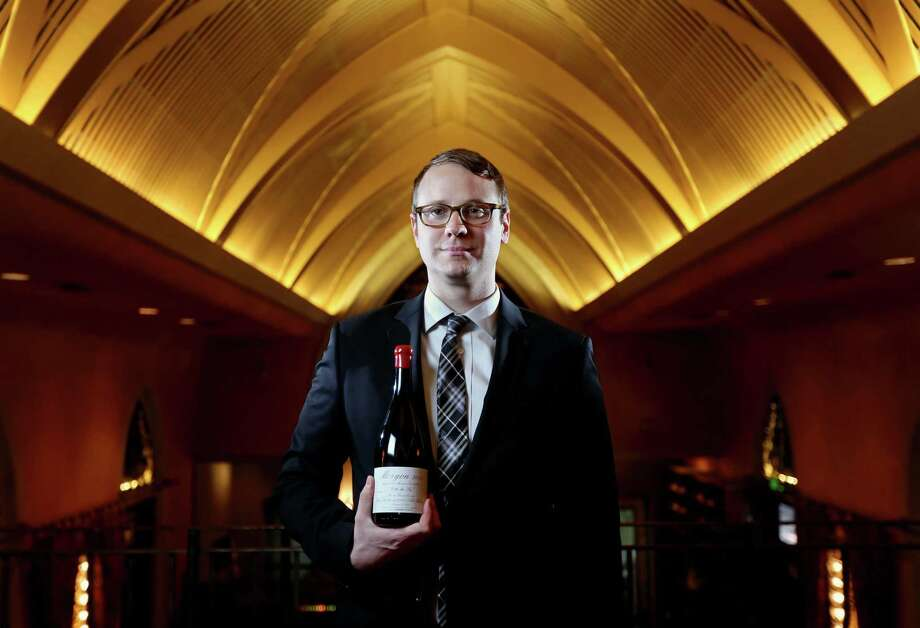 Marcus Gausepohl, wine director, shown with a bottle of Morgon 2013 at Mark's American Cuisine Thursday, July 16, 2015, in Houston. ( Gary Coronado / Houston Chronicle ) Photo: Gary Coronado, Staff / © 2015 Houston Chronicle